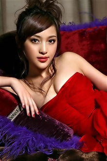 Beautiful asian girl red dress, lying on sofa iPhone Wallpaper Preview