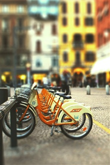 Bicycle parking, city street iPhone Wallpaper Preview
