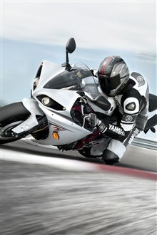 Motorcycle driving fast iPhone Wallpaper Preview