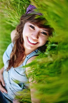 Smile girl in the grass iPhone Wallpaper Preview