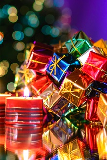 Merry Christmas, candle, colorful gifts iPhone Wallpaper Preview