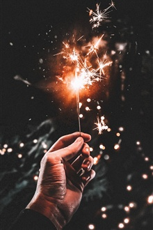 Fireworks, sparks, hand, night iPhone Wallpaper Preview