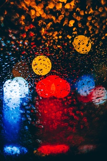 Glass, water droplets, colorful light circles iPhone Wallpaper Preview