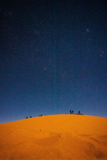 Desert, starry, sky, people iPhone Wallpaper Preview