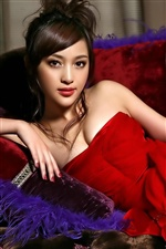 Beautiful asian girl red dress, lying on sofa iPhone wallpaper