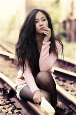 Asian girl on the tracks iPhone wallpaper