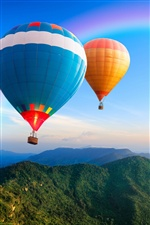 Two hot air balloons flying in the sky iPhone wallpaper
