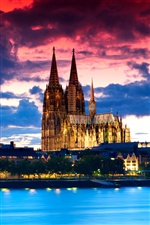 Gothic cathedral, Cologne, Germany, night, river, clouds iPhone wallpaper