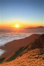 Mountain, sunrise, floating clouds, sun iPhone wallpaper
