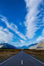New Zealand, road, mountains, blue sky, white clouds iPhone wallpaper