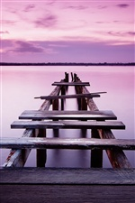 Pink sky, sunset, pier, bridge, river iPhone wallpaper