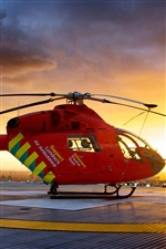 Red helicopter at city sunset iPhone Wallpaper
