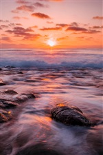 Sea, beach, waves, reefs, sun, dawn, red sky iPhone wallpaper