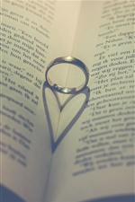Ring, book, love heart shadow iPhone wallpaper