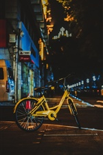 Yellow bicycle, city night iPhone wallpaper