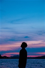 Silhouette, sea, boy, sunset iPhone Wallpaper