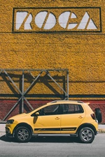 Yellow Mini car side view iPhone wallpaper