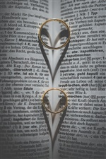 Two gold rings, love heart shadow, book iPhone wallpaper