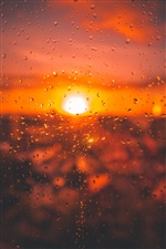 Glass surface, water droplets, sunset iPhone wallpaper
