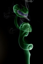 Green smoke, black background iPhone wallpaper